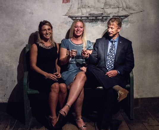 Drew celebrating his award at the IIMS gala dinner with Elle Hardham (far left) and Elly Bryant from IIMS head office