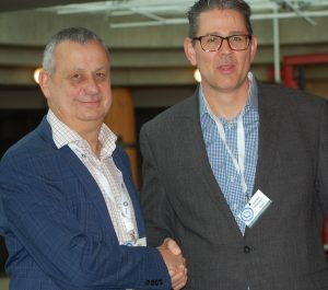 Mike Schwarz (left) congratulates Lachlan MacKenzie on his election as Branch Chairman